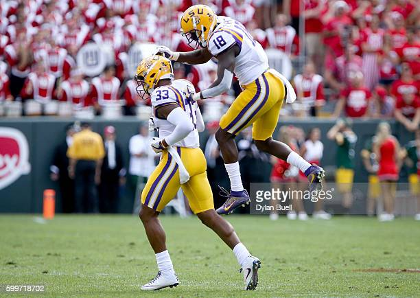 Jamal Adams and Tre'Davious White of the LSU Tigers celebrate in the first quarter against the Wisconsin Badgers at Lambeau Field on September 3 2016...