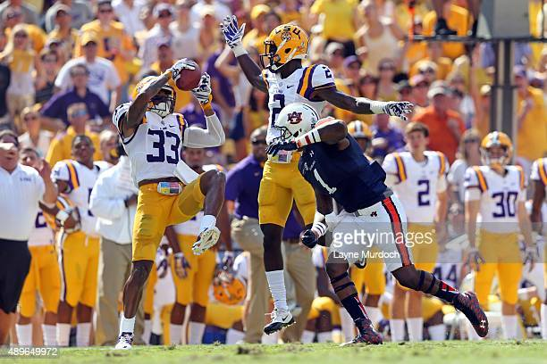 Jamal Adams of the Louisiana State University Tigers intercepts the ball against Montravius Adams of the Auburn University Tigers at Tiger Stadium on...