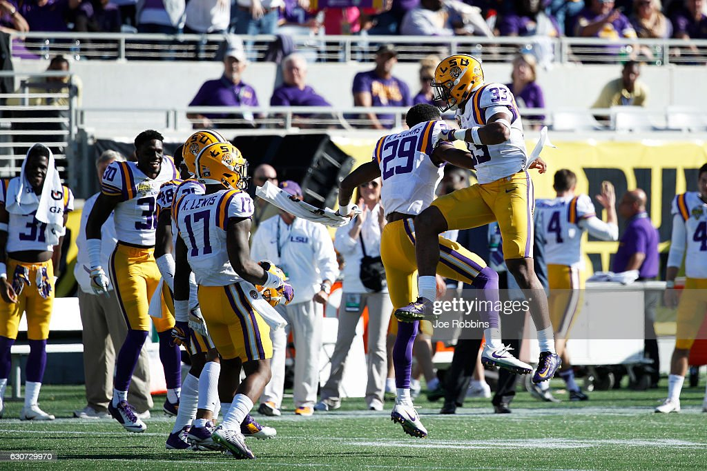 Jamal Adams #33 of the LSU Tigers celebrates with teammates after a defensive stop against the Louisville Cardinals in the fourth quarter of the Buffalo Wild Wings Citrus Bowl at Camping World Stadium on December 31, 2016 in Orlando, Florida. LSU defeated Louisville 29-9.