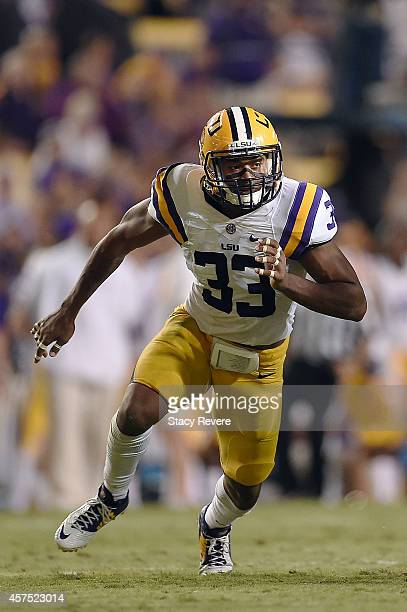 Jamal Adams of the LSU Tigers rushes the passer during a game against the Kentucky Wildcats at Tiger Stadium on October 18 2014 in Baton Rouge...