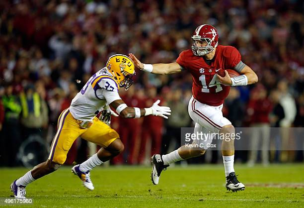 Jamal Adams of the LSU Tigers stops quarterback Jake Coker of the Alabama Crimson Tide from getting a first down in the first quarter at BryantDenny...