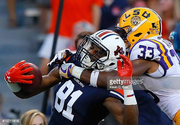 Jamal Adams of the LSU Tigers tackles Darius Slayton of the Auburn Tigers at JordanHare Stadium on September 24 2016 in Auburn Alabama