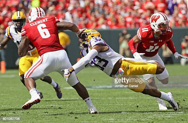 Jamal Adams of the LSU Tigers tries to tackle Corey Clement of the Wisconsin Badgers at Lambeau Field on September 3 2016 in Green Bay Wisconsin