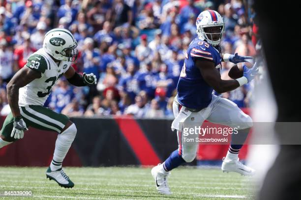 Jamal Adams of the New York Jets attempts to run down Charles Clay of the Buffalo Bills during the first half on September 10 2017 at New Era Field...