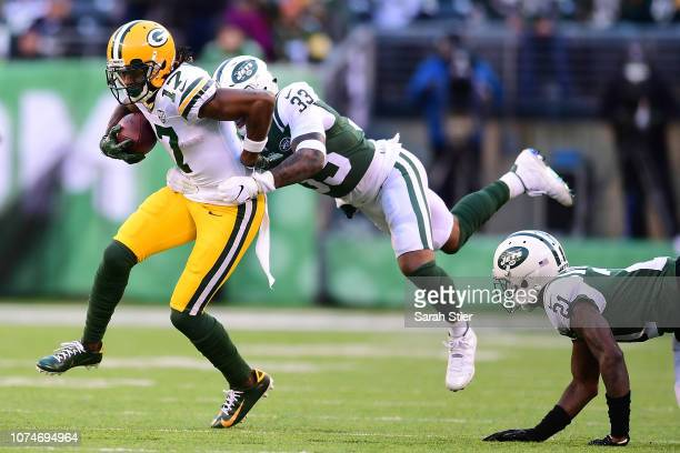 Jamal Adams of the New York Jets attempts to tackle Davante Adams of the Green Bay Packers during the third quarter at MetLife Stadium on December 23...