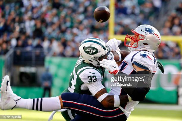 Jamal Adams of the New York Jets breaks up a pass intended for Rob Gronkowski of the New England Patriots during the first quarter at MetLife Stadium...