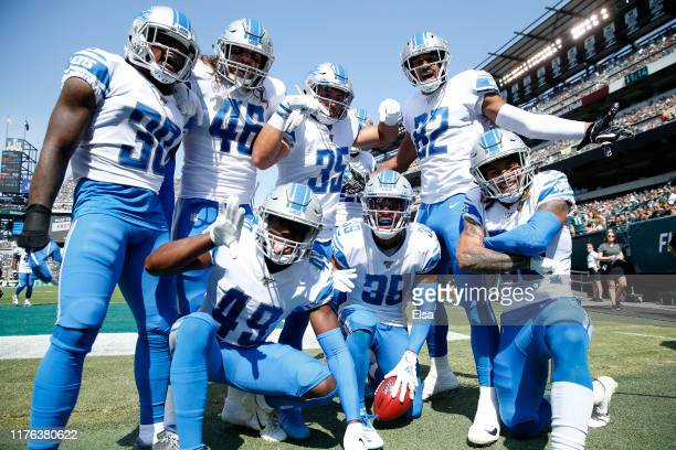 Jamal Agnew of the Detroit Lions celebrates his 100 yard kick off return for a touchdown with teammates Dee Virgin,Nick Bawden,C.J. Moore,Miles...