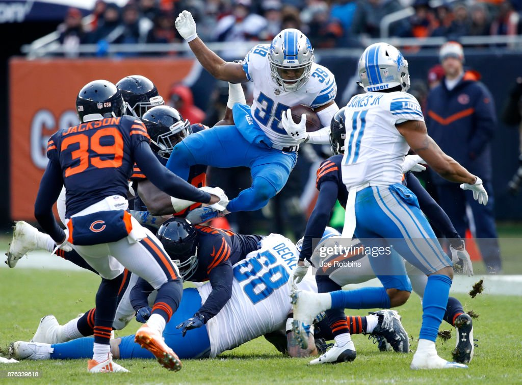 Jamal Agnew #39 of the Detroit Lions jumps over players while carrying the football in the third quarter against the Chicago Bears at Soldier Field on November 19, 2017 in Chicago, Illinois.