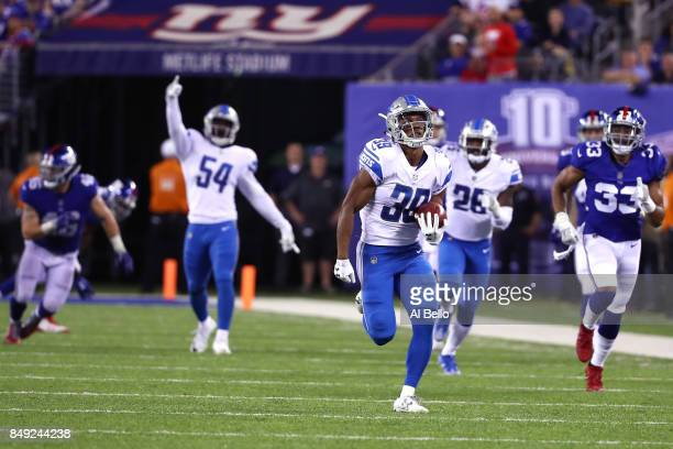 Jamal Agnew of the Detroit Lions returns an 88 yard punt return for a touchdown in the fourth quarter against the New York Giants during their game...