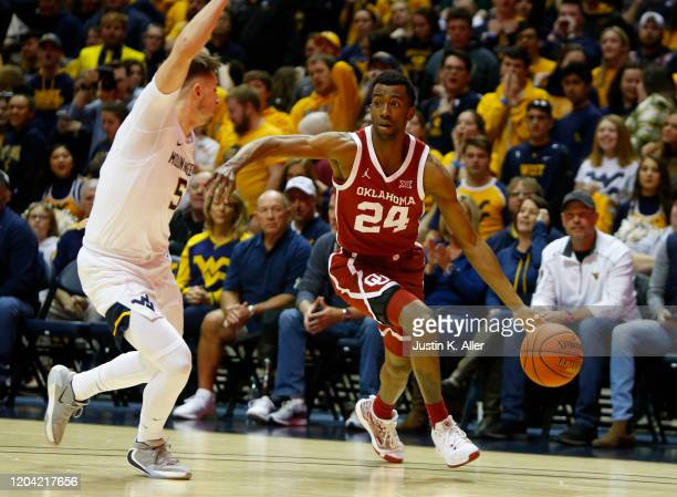 Jamal Bieniemy of the Oklahoma Sooners drives against Jordan McCabe of the West Virginia Mountaineers at the WVU Coliseum on February 29 2020 in...