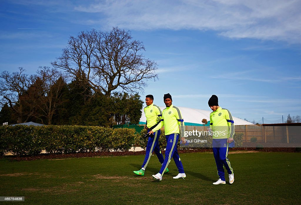 Jamal Blackman, Didier Drogba and Eden Hazard walk to the pitch during a Chelsea training session ahead of the UEFA Champions League Round of 16 second leg match against Paris Saint-Germain at Chelsea Training Ground on March 10, 2015 in Cobham, England.
