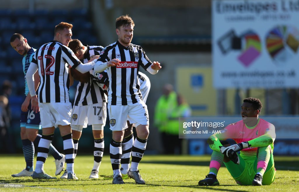Jamal Blackman of Wycombe Wanderers sits dejected as Matt Tootle of Notts County and his team mates celebrate after Shola Ameobi scores to make it 0-1 during the Sky Bet League Two match between Wycombe Wanderers and Notts County at Adams Park on March 25, 2017 in High Wycombe, England.