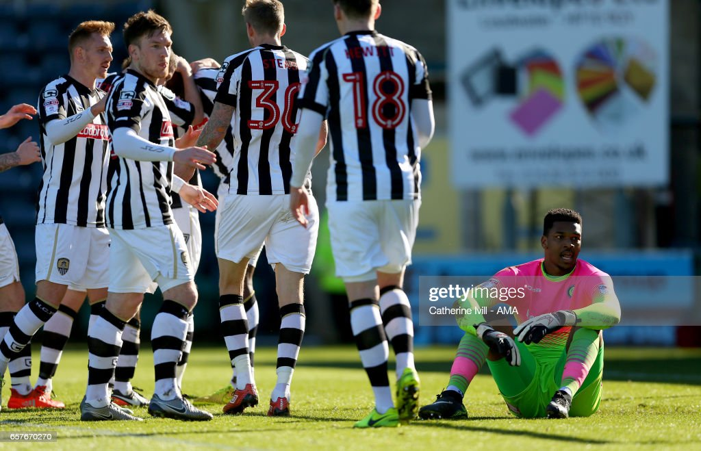 Jamal Blackman of Wycombe Wanderers sits dejected as Notts County celebrate after Shola Ameobi of Notts County scores to make it 0-1 during the Sky Bet League Two match between Wycombe Wanderers and Notts County at Adams Park on March 25, 2017 in High Wycombe, England.