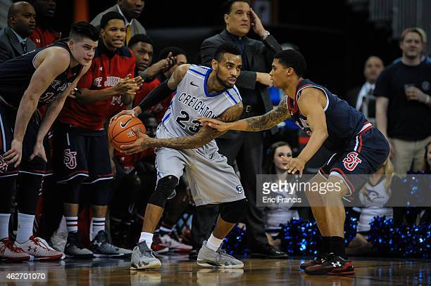 Jamal Branch of the St John's Red Storm defends James Milliken of the Creighton Bluejays during their game at CenturyLink Center January 28 2015 in...