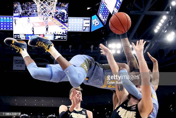 Jamal Cain of the Marquette Golden Eagles fouls Evan Boudreaux of the Purdue Boilermakers during a shot attempt in the first half at the Fiserv Forum...