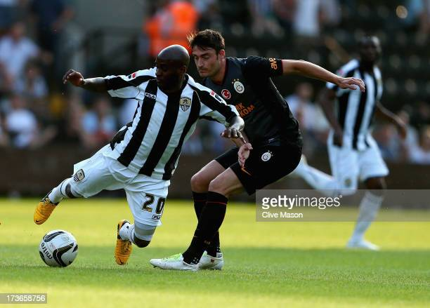 Jamal CampbellRyce of Notts County is tackled by Albert Riera of Galatasaray during the pre season friendly match between Notts County and...