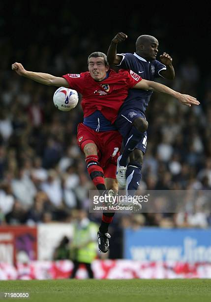 Jamal CampbellRyce of Southend jumps with Kevin McNaughton of Cardiff during the Coca Cola Championship match between Southend United and Cardiff...