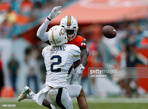 Jamal Carter of the Miami Hurricanes breaks up the pass intended for Ricky Jeune of the Georgia Tech Yellow Jackets on November 21 2015 at Sun Life...