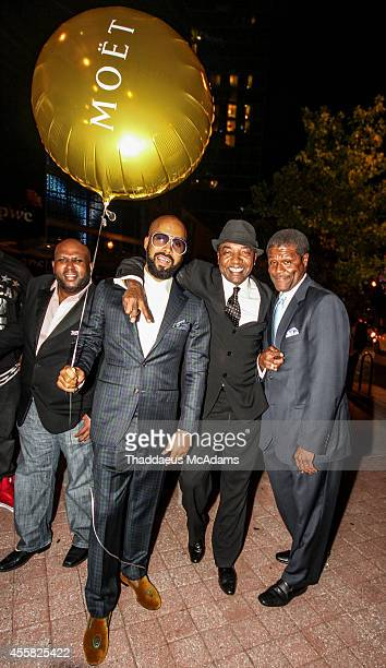 Jamal Coleman Kenny Burns Michael Mauldin and Magic attend the executive lounge presented by Moet Chandon at STK on September 19 2014 in Atlanta...