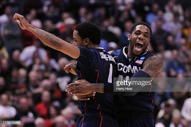 Jamal CoombsMcDaniel and Alex Oriakhi of the Connecticut Huskies celebrate after defeating the San Diego State Aztecs during the west regional...