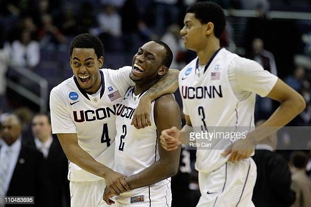 Jamal Coombs-McDaniel, Donnell Beverly and Jeremy Lamb of the Connecticut Huskies celebrate their 69-58 win over the Cincinnati Bearcats during the...