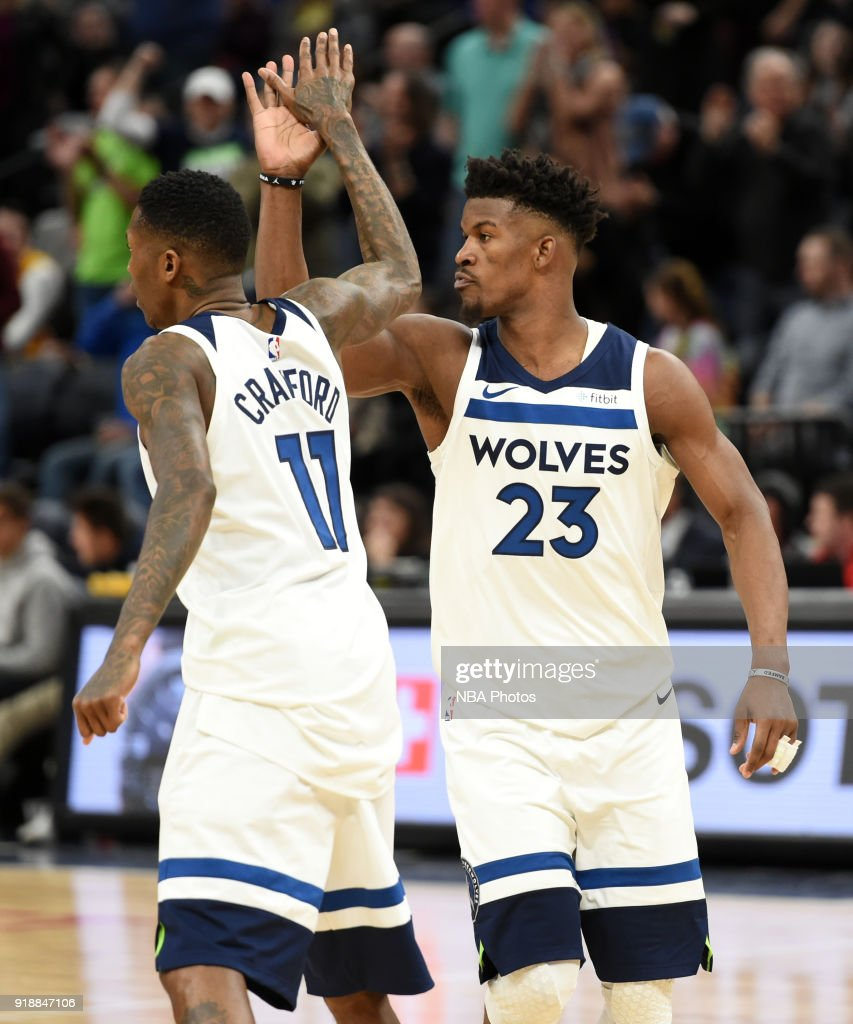 Jamal Crawford #11 and Jimmy Butler #23 of the Minnesota Timberwolves high five during the game against the Los Angeles Lakers on February 15, 2018 at Target Center in Minneapolis, Minnesota.