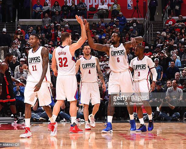 Jamal Crawford Blake Griffin DeAndre Jordan and Chris Paul of the LA Clippers show emotion during the game against the Toronto Raptors at STAPLES...
