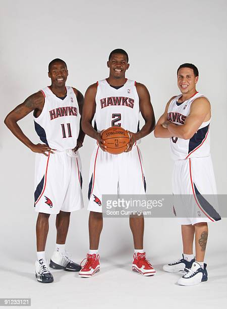 Jamal Crawford Joe Johnson and Mike Bibby of the Atlanta Hawks pose during 2009 NBA Media Day on September 28 2009 at Philips Arena in Atlanta...