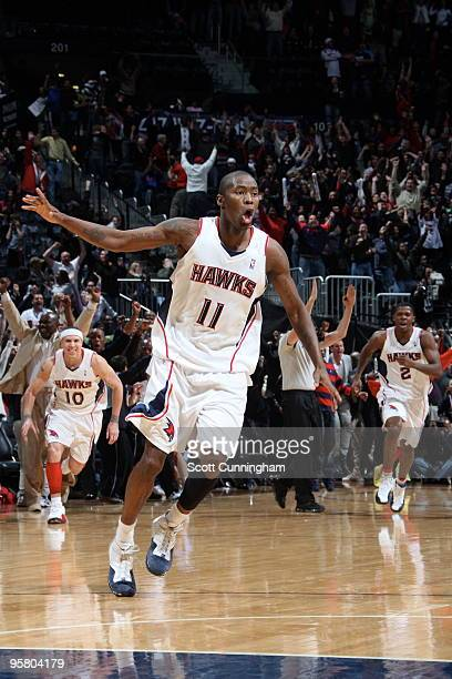Jamal Crawford of the Atlanta Hawks celebrates after hitting the gamewinning 3 pointer against the Phoenix Suns on January 15 2010 at Philips Arena...