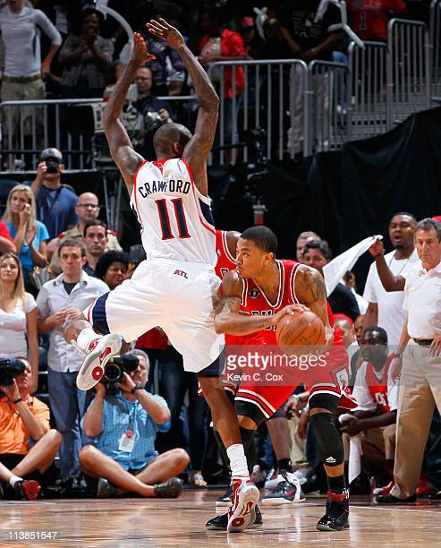 Jamal Crawford of the Atlanta Hawks defends Derrick Rose of the Chicago Bulls in Game Four of the Eastern Conference Semifinals in the 2011 NBA...