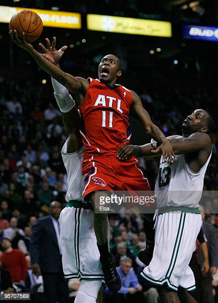 Jamal Crawford of the Atlanta Hawks goes up for two past Ray Allen and Kendrick Perkins of the Boston Celtics at the TD Garden on January 11 2010 in...
