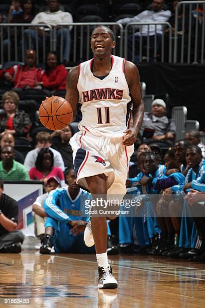 Jamal Crawford of the Atlanta Hawks moves the ball up court during the preseason game against the New Orleans Hornets at Philips Arena on October 7...