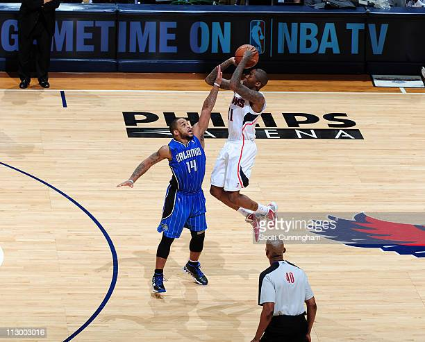 Jamal Crawford of the Atlanta Hawks puts the game away by hitting a threepoint shot against Jameer Nelson of the Orlando Magic in Game Three of the...