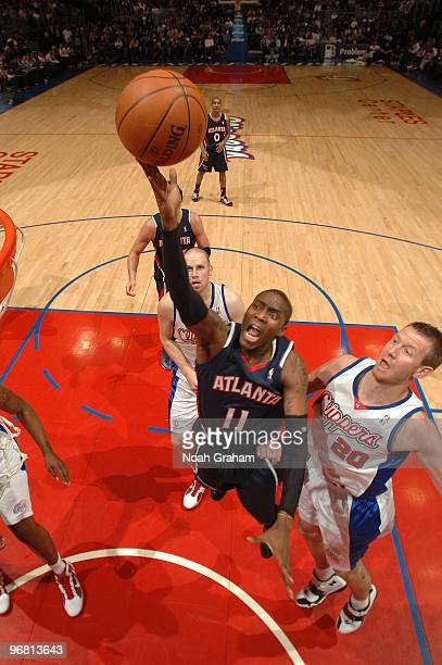 Jamal Crawford of the Atlanta Hawks puts up a shot against Steve Novak of the Los Angeles Clippers at Staples Center on February 17 2010 in Los...