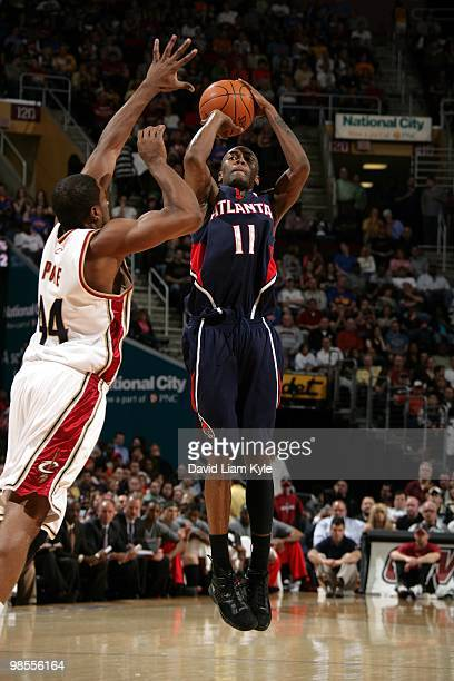 Jamal Crawford of the Atlanta Hawks shoots a jump shot against Leon Powe of the Cleveland Cavaliers during the game at Quicken Loans Arena on April...