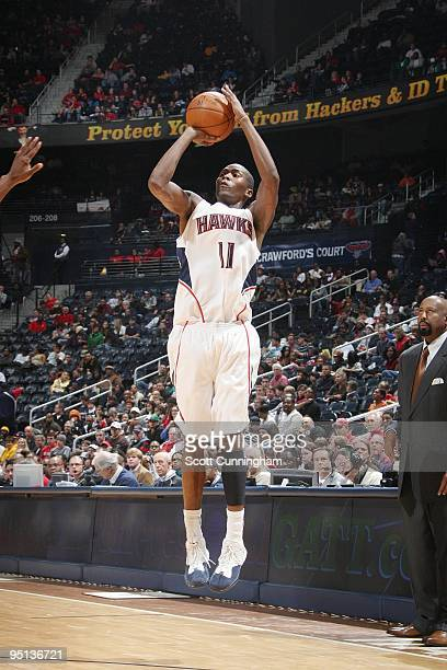Jamal Crawford of the Atlanta Hawks shoots a jump shot during the game against the New Jersey Nets at Philips Arena on December 13 2009 in Atlanta...