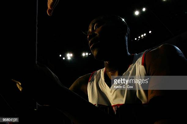 Jamal Crawford of the Atlanta Hawks signs an autograph after hitting a gamewinning threepoint basket against the Phoenix Suns at Philips Arena on...