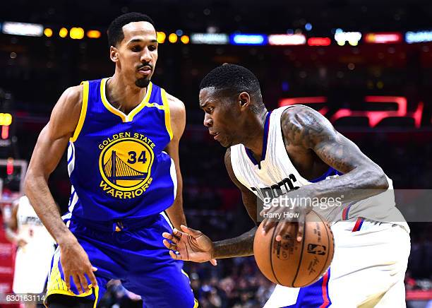 Jamal Crawford of the LA Clippers dribbles as he is guarded by Shaun Livingston of the Golden State Warriors at Staples Center on December 7, 2016 in...