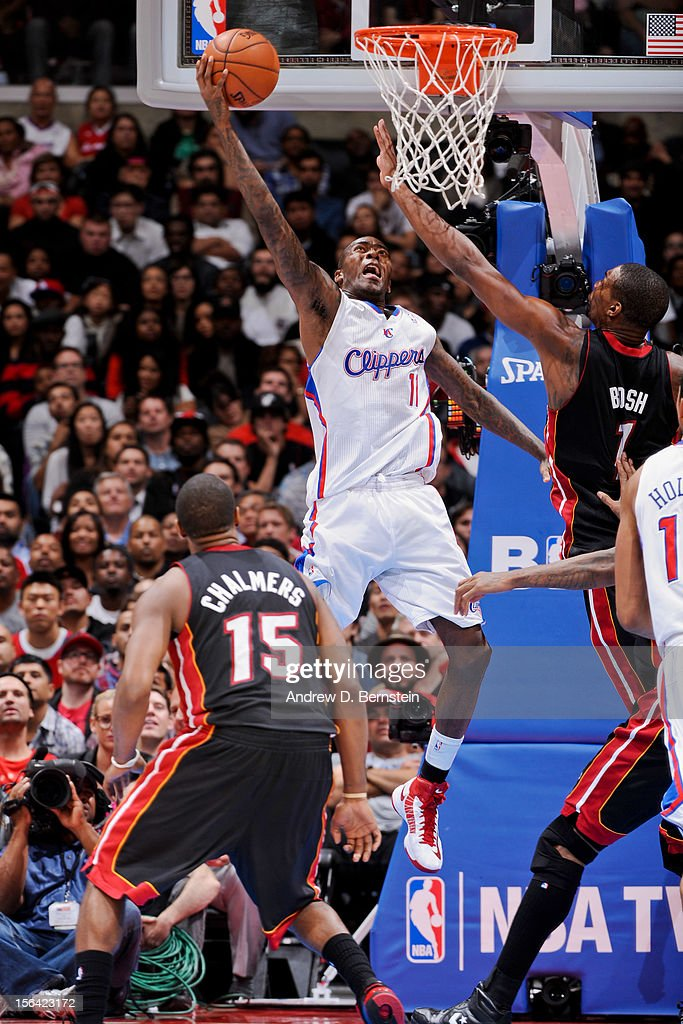 Jamal Crawford #11 of the Los Angeles Clippers attempts a reverse layup against Chris Bosh #1 of the Miami Heat at the Staples Center on November 14, 2012 in Los Angeles, California.