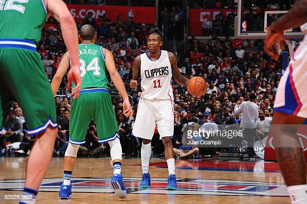 Jamal Crawford of the Los Angeles Clippers defends the ball against the Dallas Mavericks during the game on April 10 2016 at STAPLES Center in Los...