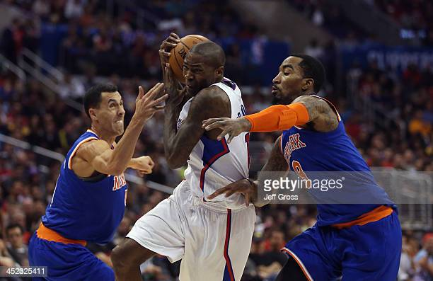 Jamal Crawford of the Los Angeles Clippers drives to the basket between Pablo Prigioni and JR Smith of the New York Knicks in the second half at...