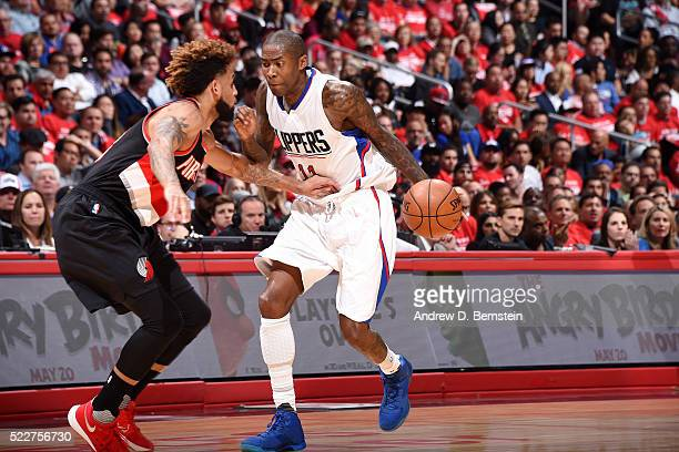 Jamal Crawford of the Los Angeles Clippers handles the ball during the game against Allen Crabbe of the Portland Trail Blazers in Game Two of the...
