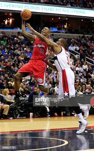 Jamal Crawford of the Los Angeles Clippers puts up a shot in front of Martell Webster of the Washington Wizards during the second half of the...