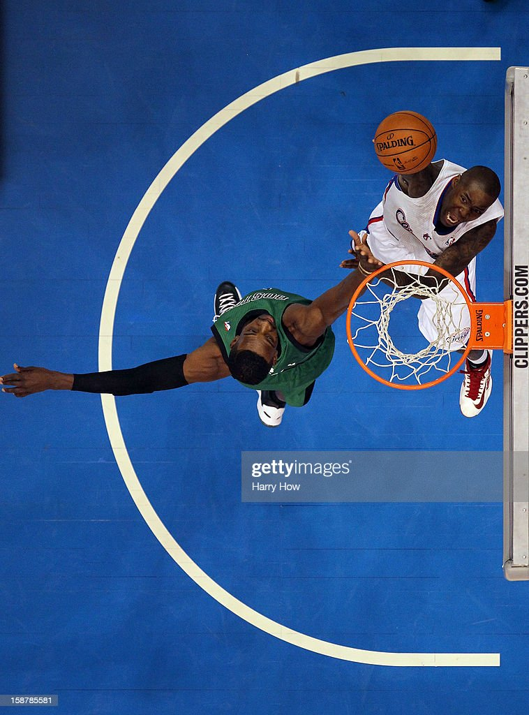 Jamal Crawford #11 of the Los Angeles Clippers scores on a layup by Jeff Green #8 of the Boston Celtics during a 16-77 Clippers victory for 15 straight wins at Staples Center on December 27, 2012 in Los Angeles, California.
