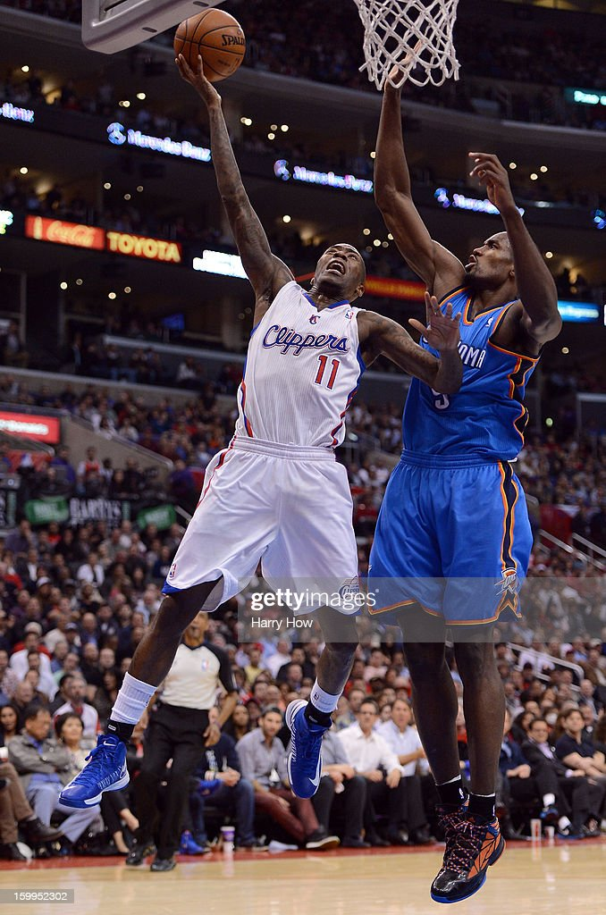 Jamal Crawford #11 of the Los Angeles Clippers scores on a layup past Serge Ibaka #9 of the Oklahoma City Thunder during a 109-97 Thunder win at Staples Center on January 22, 2013 in Los Angeles, California.