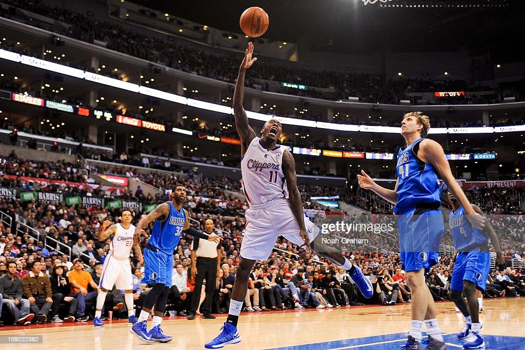 Jamal Crawford #11 of the Los Angeles Clippers shoots a layup against Dirk Nowitzki #41 of the Dallas Mavericks at Staples Center on January 9, 2013 in Los Angeles, California.