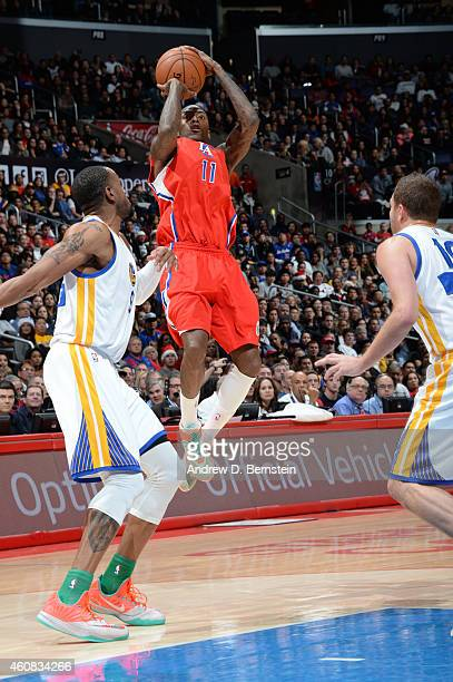 Jamal Crawford of the Los Angeles Clippers shoots during a game against the Golden State Warriors at STAPLES Center on December 25 2014 in Los...