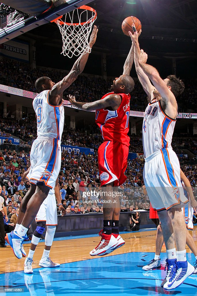 Jamal Crawford #11 of the Los Angeles Clippers shoots in the lane against Serge Ibaka #9 of the Oklahoma City Thunder on November 21, 2012 at the Chesapeake Energy Arena in Oklahoma City, Oklahoma.