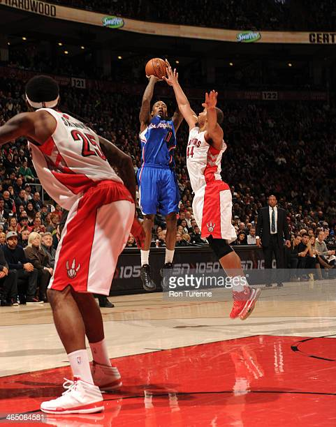 Jamal Crawford of the Los Angeles Clippers shoots the ball against the Toronto Raptors on January 25 2014 at the Air Canada Centre in Toronto Ontario...
