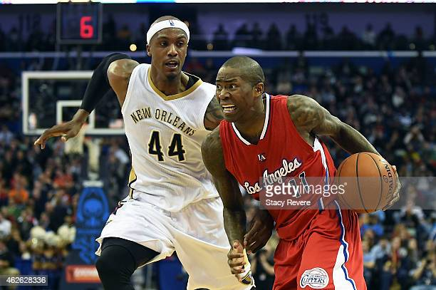 Jamal Crawford of the Los Angeles Clippers works against Dante Cunningham of the New Orleans Pelicans during the second half of a game at the...